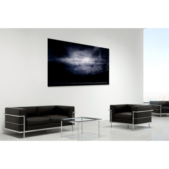 An airplane's jet stream is dwarfed below a gigantic cloud formation over Cave Hill, Northern Ireland - contemporary fine art photograph of Ireland by Stephen S T Bradley entitled Fellow Travellers. Print shown in room setting.