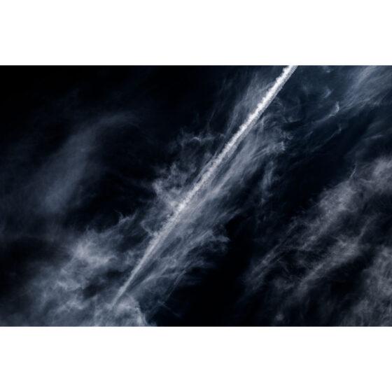 Airplane jetstream below gigantic cloud formation over Newtownabbey Fine Art Photograph of Ireland by Stephen S T Bradley Photographer Cutting Through the Dross 4933