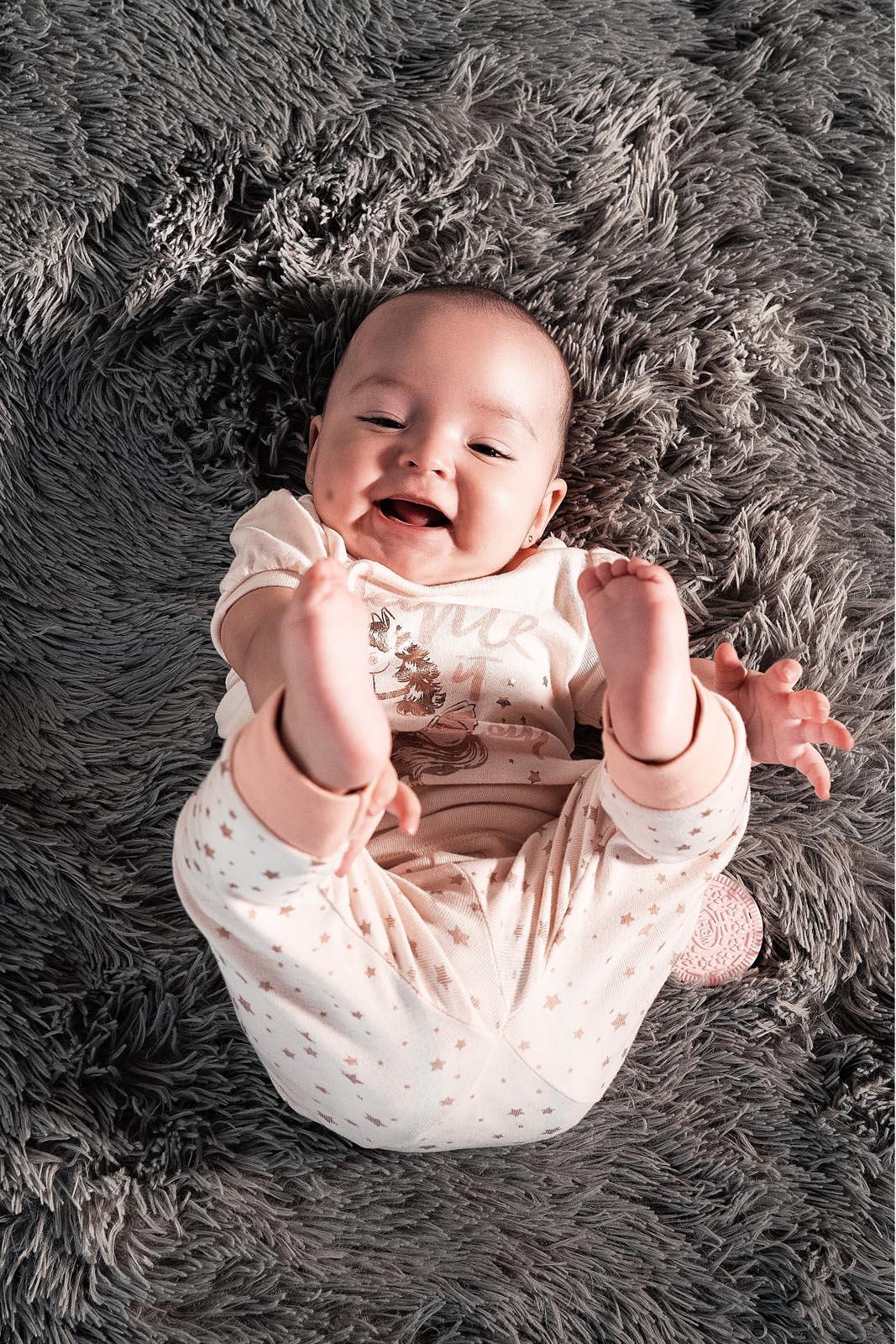 Baby photographer Belfast - cute baby lying on fur carpet photo 3969272
