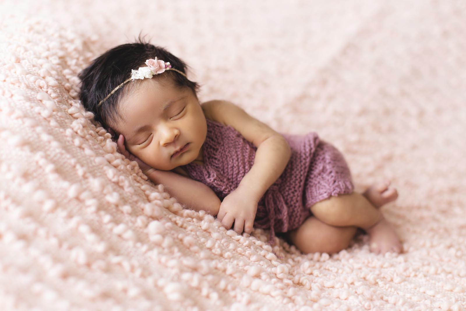 Baby photographers Belfast - baby lying in pink fleece 1442005