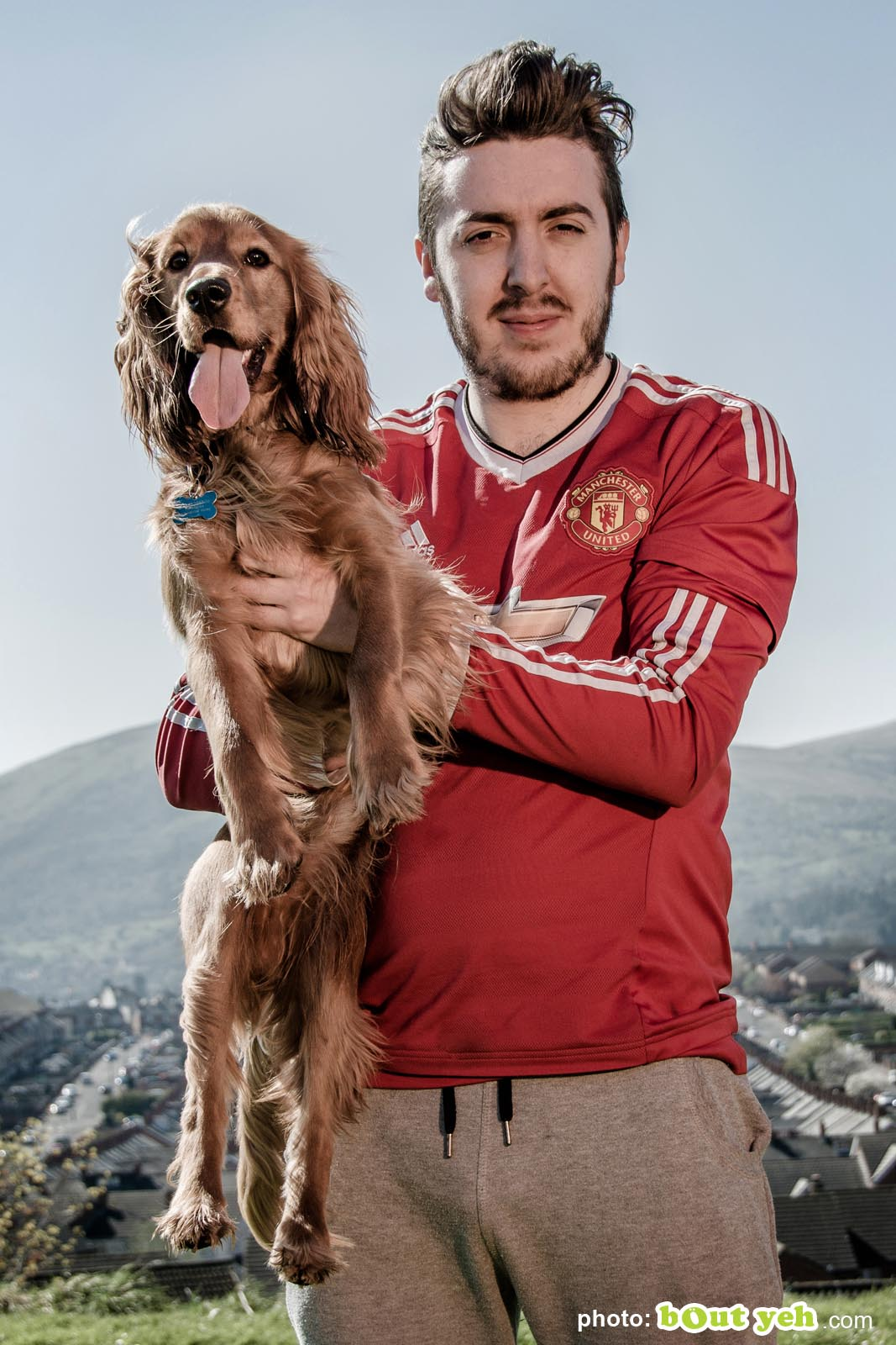 Young man holding his spaniel dog at Marrowbone Park, Belfast - photo 5311