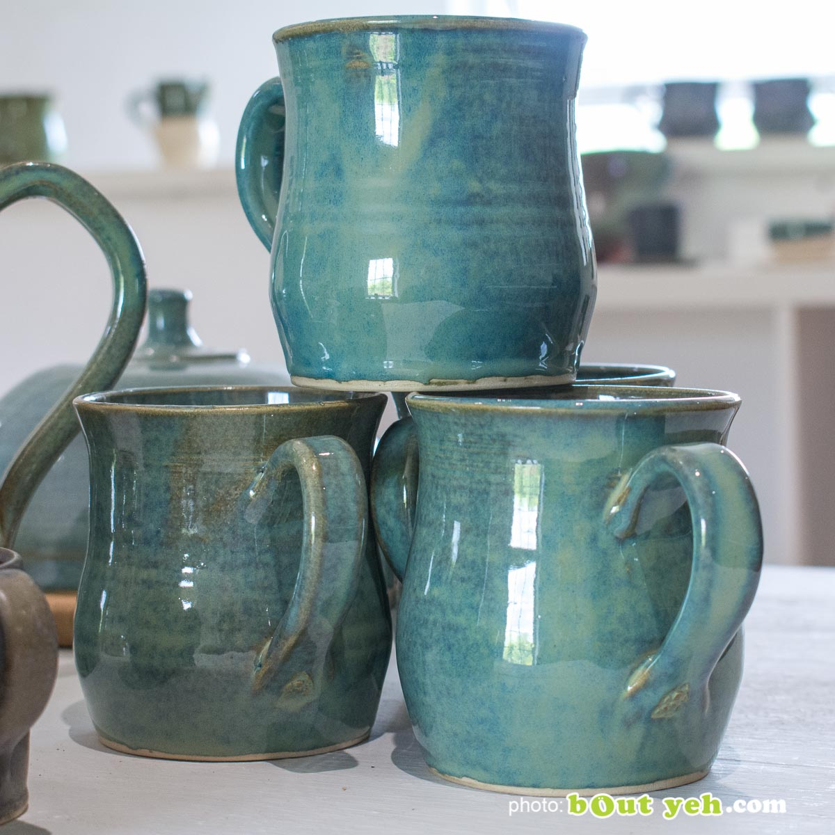 Contemporary hand made Irish pottery - tiffany blue and green curve-sided mug from Bout Yeh arts and crafts gallery Belfast and Dublin. Photo 1463