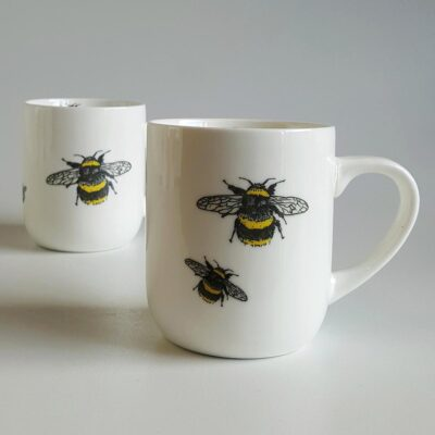 Ceramic mugs with bee decals. Irish ceramics an