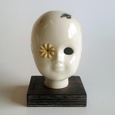 Daisy - ceramic human head with bee related ornamentation. Irish ceramics and porcelain for sale by Bout Yeh art and crafts gallery Belfast and Dublin, Ireland