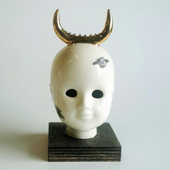 Golden Cow - ceramic human head with golden reindeeer horns. Irish ceramics and porcelain for sale by Bout Yeh art and crafts gallery Belfast and Dublin, Ireland