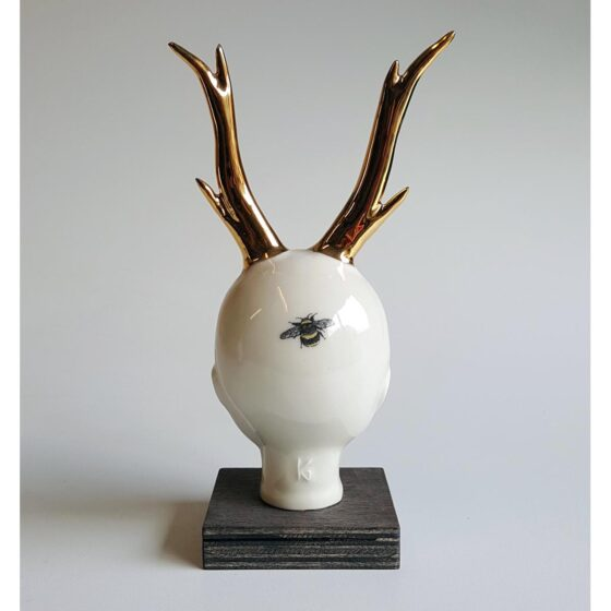 Reindeer Goldy - ceramic human head with golden reindeeer horns. Irish ceramics and porcelain for sale by Bout Yeh art and crafts gallery Belfast and Dublin, Ireland