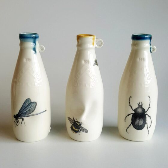 Three ceramic Irish milk bottles with insect decals. Irish ceramics and porcelain for sale by Bout Yeh art and crafts gallery Belfast and Dublin, Ireland