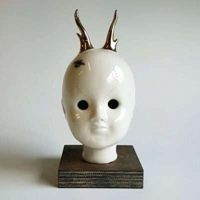 Young Buck - ceramic human head with golden reindeeer horns. Irish ceramics and porcelain for sale by Bout Yeh art and crafts gallery Belfast and Dublin, Ireland