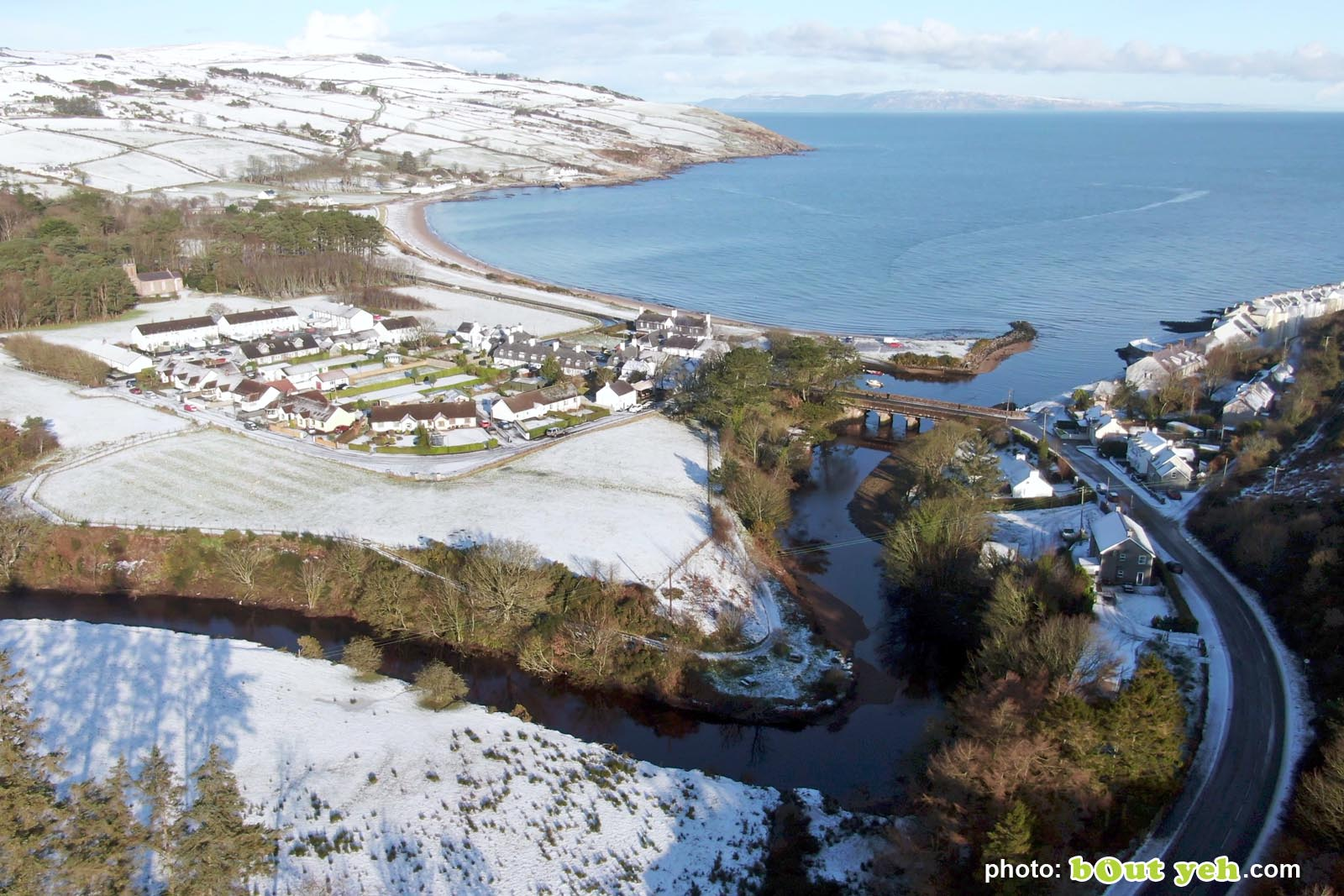 Aerial video of Cushendun under snow in winter by Bout Yeh photography and video production Belfast and Northern Ireland - video screenshot 3