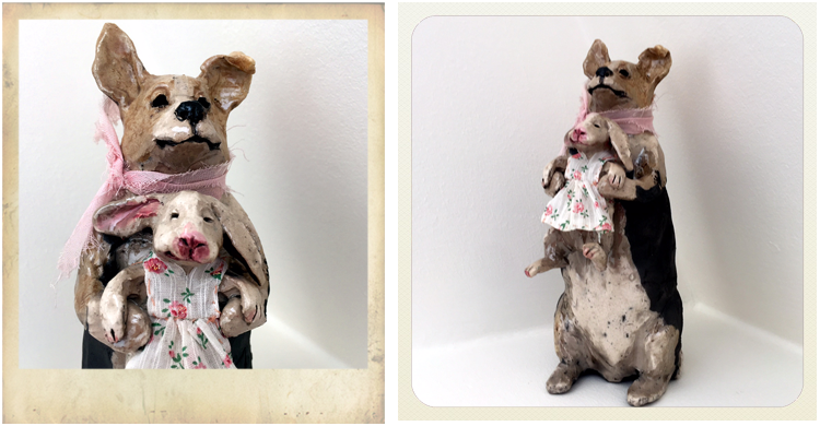 ceramic dog holding rabbit by Lisa Schumaier at the Torpedo Art Factory