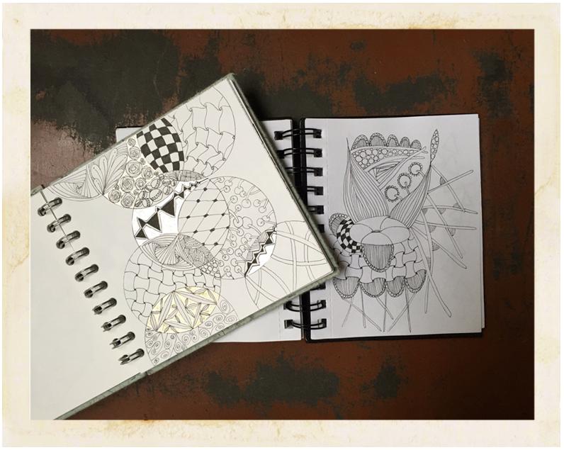2 open sketchbooks showing geometric drawings