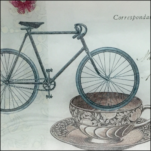 bike, cup, postage stamp and flower decoupage glass dish closeup