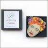 frida kahlo brooch with orange flower and butterfly in gift box