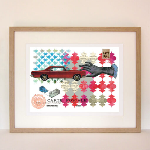 framed giclee print of a vintage mid-century american red car being held by a hand on a patterned red and turquoise background