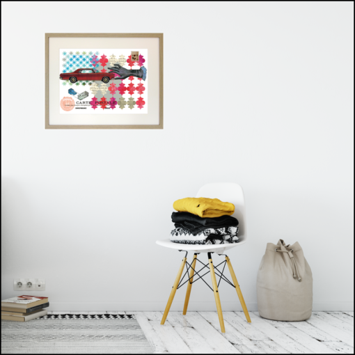 framed giclee print of a vintage mid-century american red car being held by a hand on a patterned red and turquoise background, shown on room wall