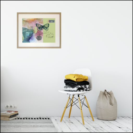 framed giclee print of a crset, a butterfly, maps of the tropics, handwriting and a vintage stamp, shown on a living room wallng room wall