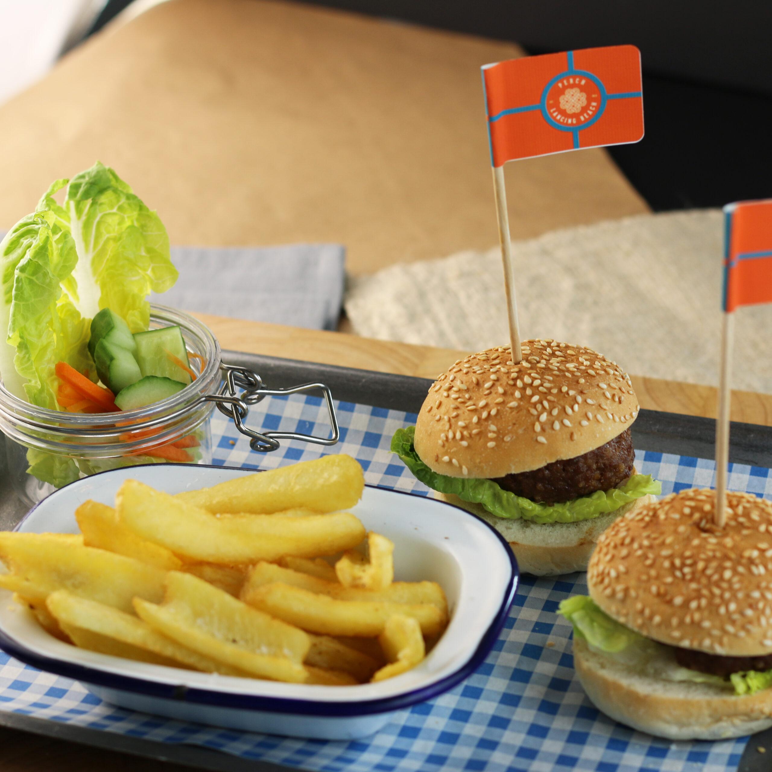 Kids mini burgers with a bowl of fries and mason jar of salad