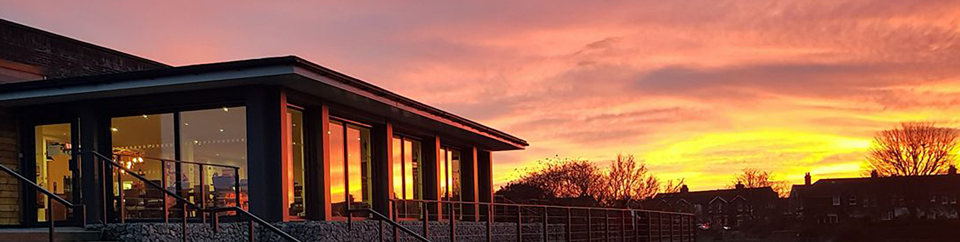 Vibrant sunset reflecting off the building at Perch in Princes Park