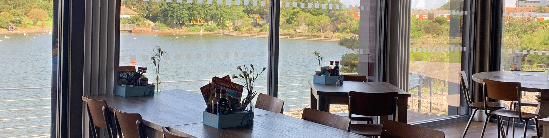 Breakfast tables and Sunny views of Princes Park lake from the Perch in Eastbourne