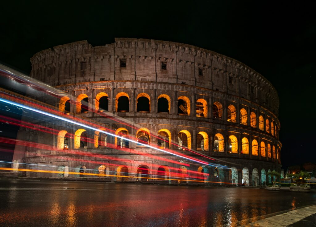 Picture of the Colosseum all lit up at night