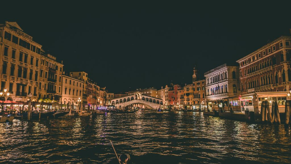 View of Rialto Bridge, a famous landmark in Venice at night