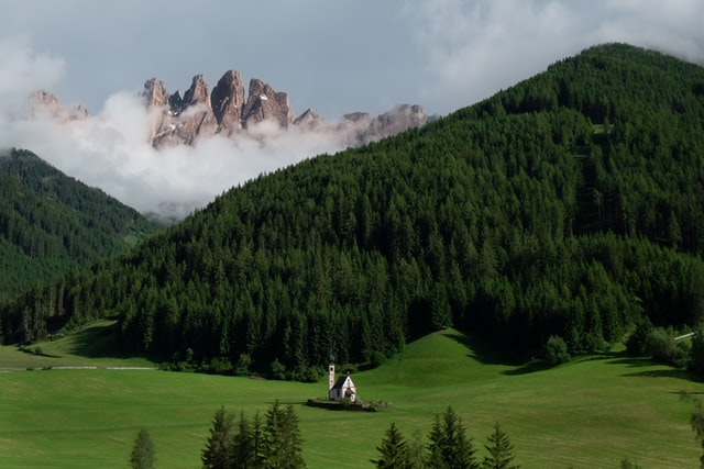 Beautiful picture of Val di Funes with the stunning mountains and green landscape around, one of the most beautiful dolomite attractions to visit.