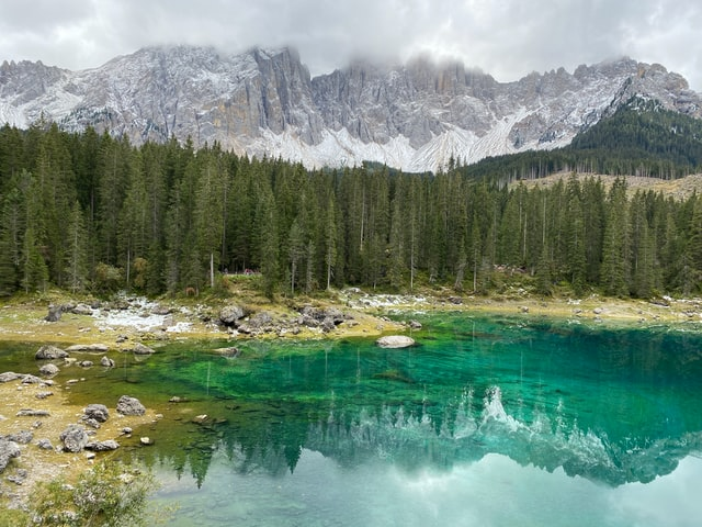 Beautiful shot of lago di Carezza, with the stunning backdrop of the dolomites behind