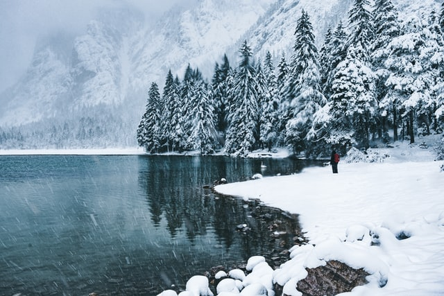 Winter picture of the beautiful Lago di Dobbiaco covered in snow