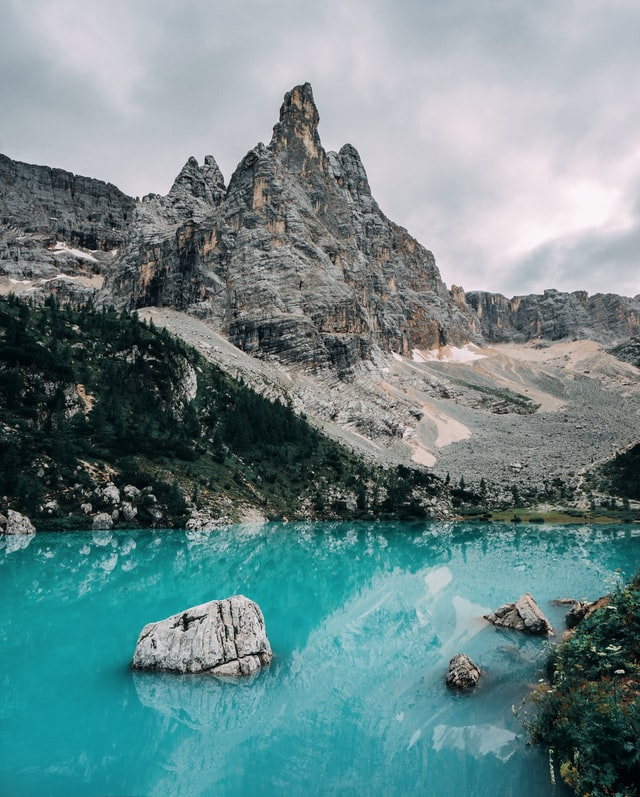 Beautiful blue water of the Lake Sorapis with the stunning mountains in the background, one of the best things to do in the Dolomites