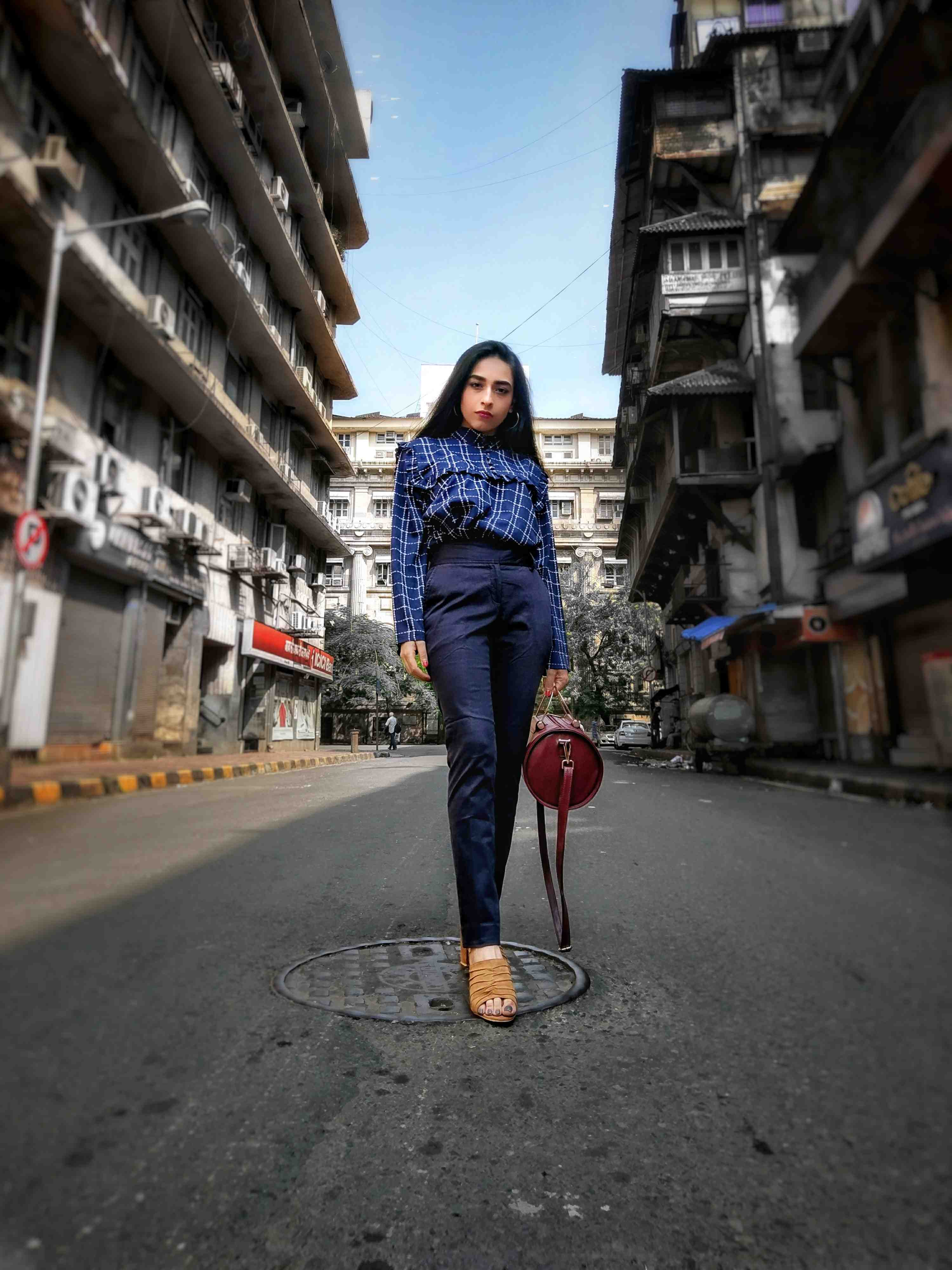 work outfit, work wear, monday to friday, formal wear, navy pants, fashion week, street style, bombay streets, ruffles, ruffled shirt, checkered shirt style,