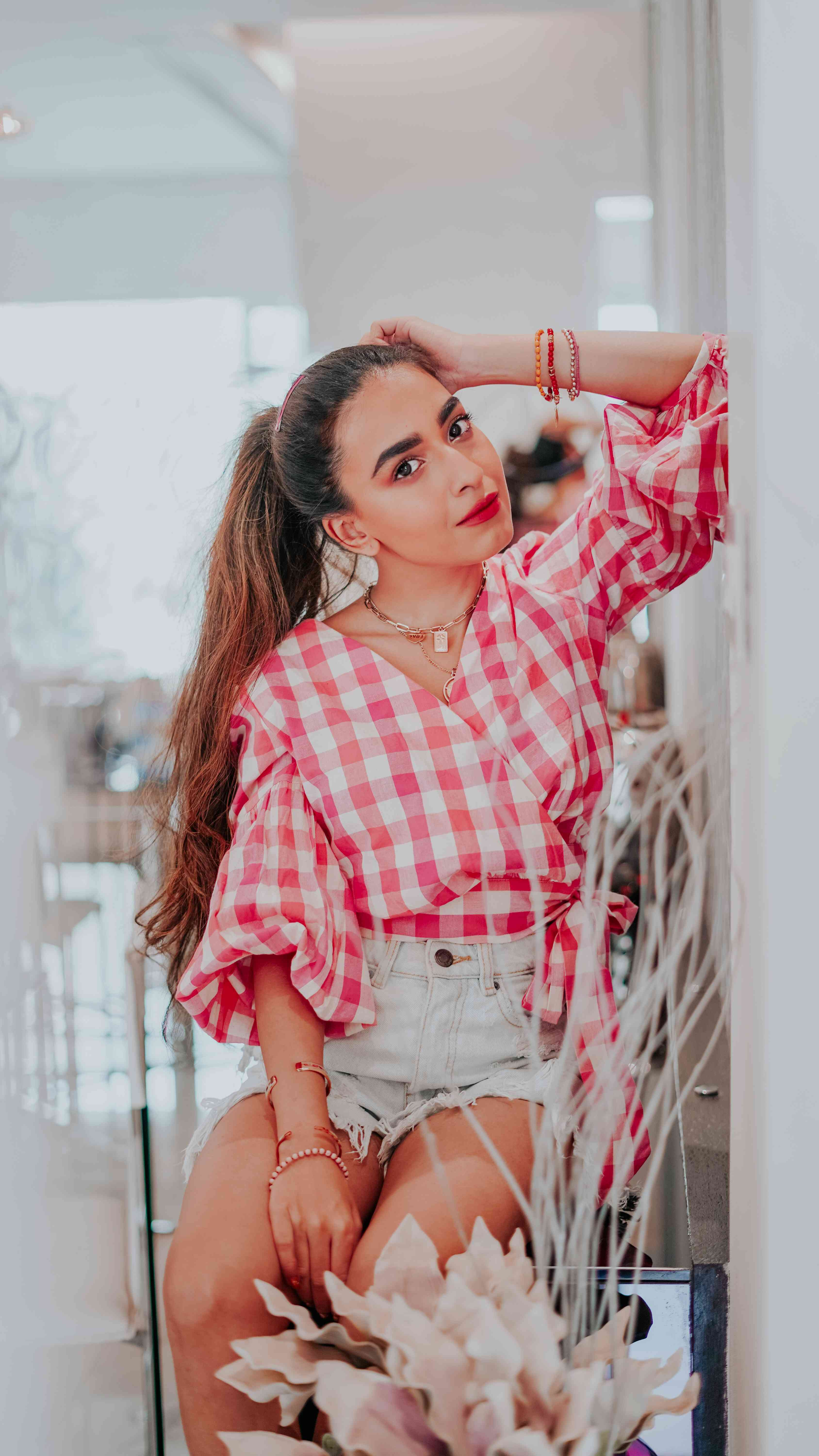 pink gingham wrap round top outfit - street style, high ponytail