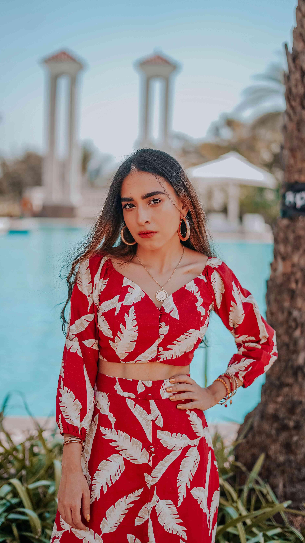 Neha Menghwani, Stylessential, Indian Blogger,model posing in red printed top