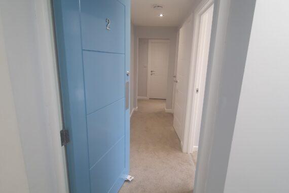 Top Drawer Construction bespoke carpentry blue front door fitting studio flat Woking Weybridge Surrey