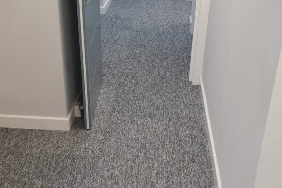 Top Drawer Construction white door and carpet fitting in apartment hallway Woking Weybridge Surrey