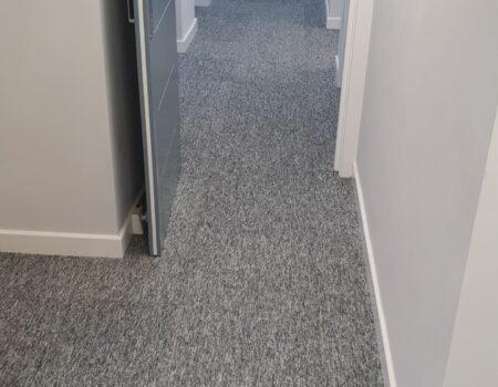 Top Drawer Construction white door and carpet fitting in apartment hallway Woking Weybridge Surrey