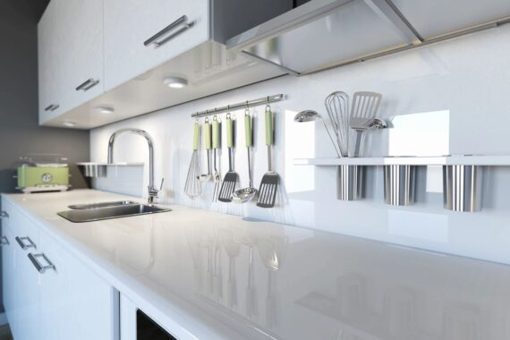 Top Drawer Construction white and chrome kitchen fitting with tap, sink and utensils Woking Weybridge Surrey