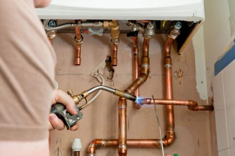 A local Top Drawer Construction plumber fixing and installing home boiler heating system Woking Weybridge Surrey
