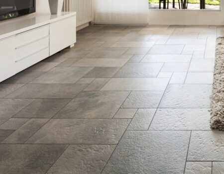 Grey stone tiled kitchen flooring installed by Top Drawer Construction Woking Weybridge Surrey