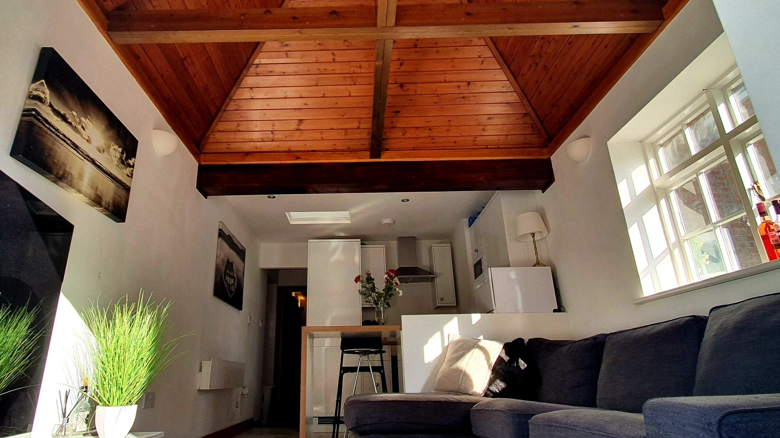 Top Drawer Construction open plan kitchen living room garage conversion with raised roof and timber cladding in Ottershaw Surrey