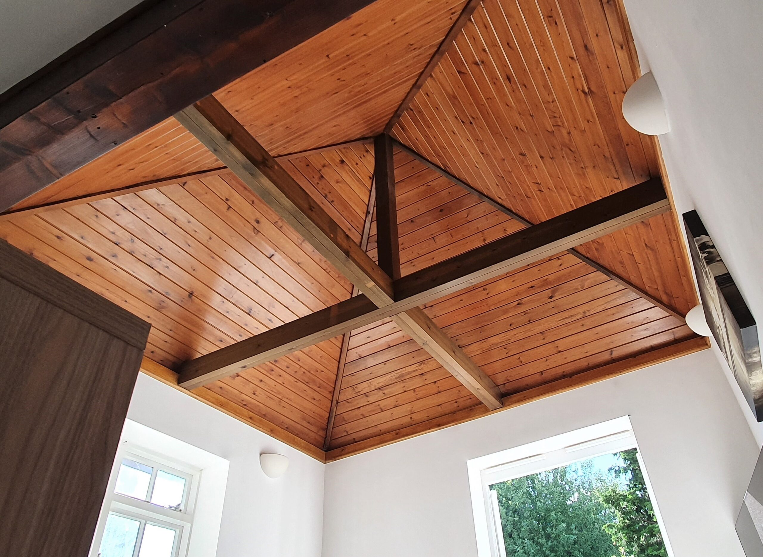 Top Drawer Construction open roof with cladding inside a white living room Ottershaw Surrey