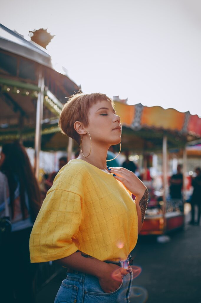 Girl In Yellow Top & Hoop Earrings At Funfair | 5 Ways To Wear Earrings To Help Them Be More Flattering | Fashion & Style | Elle Blonde Luxury Lifestyle Destination Blog