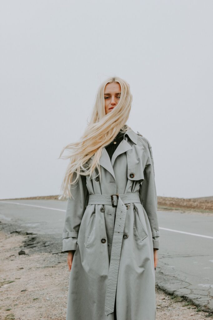Blonde girl in trench coat | 4 Tips For Creating A Greener Wardrobe For Sustainability | Fashion Tips & Guide | Elle Blonde Luxury Lifestyle Destination Blog