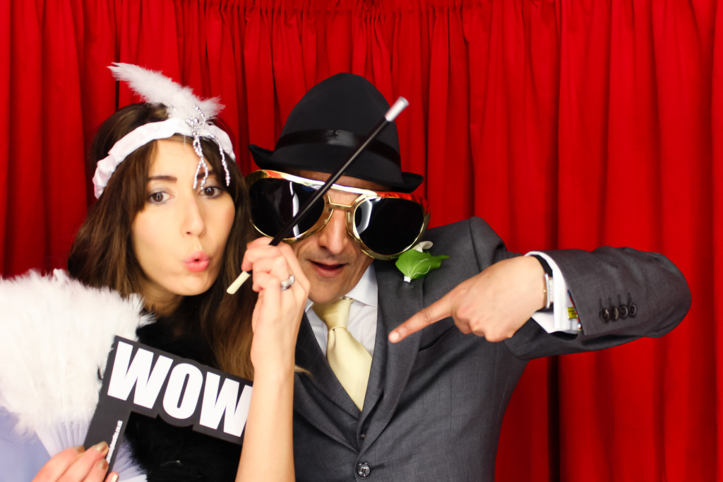 Gatsby and Gangster photo booth with WOW word prop in our white wedding booth at a wedding in Nottinghamshire