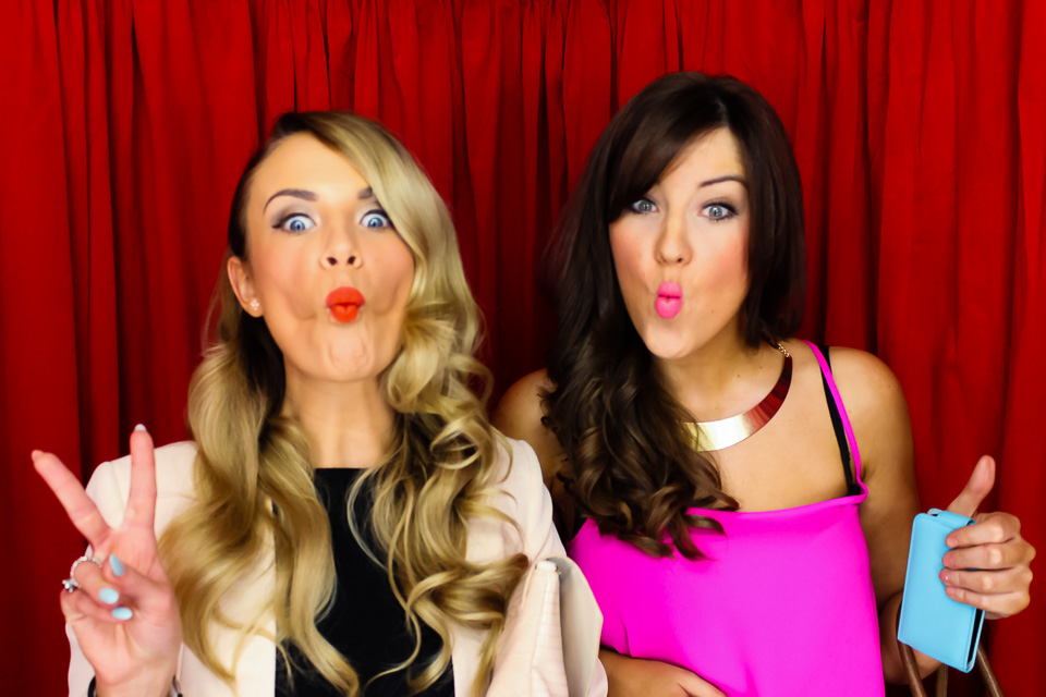 glamorous ladies in the black and red photo booth at a private party