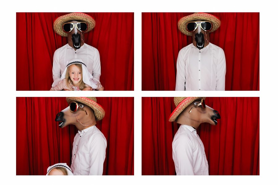 horsing around in the wedding photo booth
