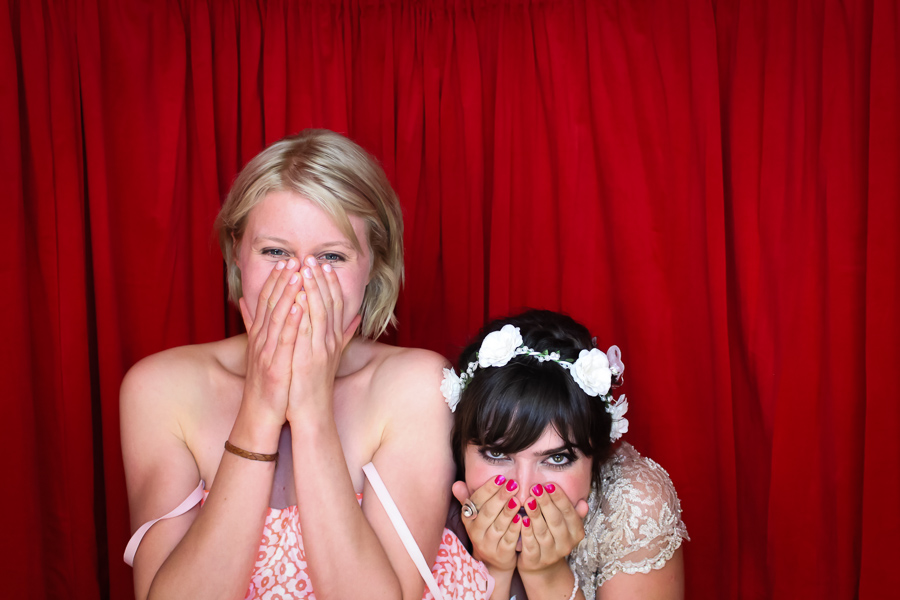 girls laughing in the photo booth
