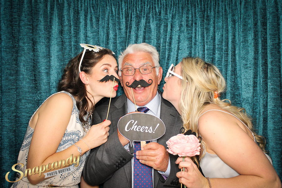 kisses in the photo booth