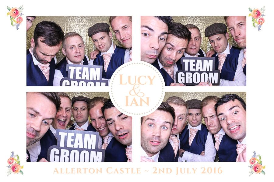 groomsmen in photo booth