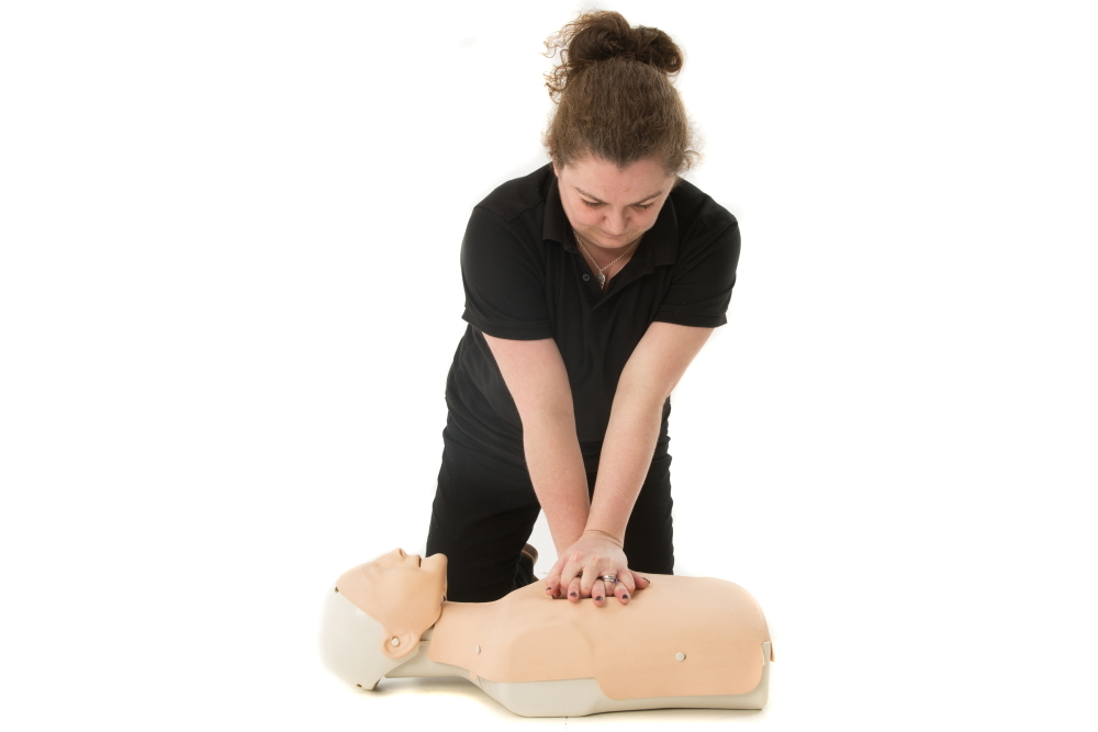 Performing CPR on a manikin