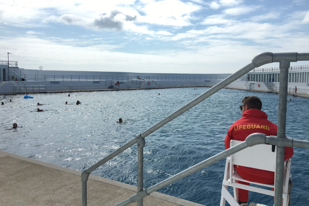 Lifeguard sat on a chair at Penzance Lido